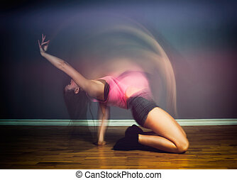 Modern hip hop dancer woman, motion blur