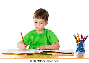 Little boy draw with pencils - Inspired little boy at the...