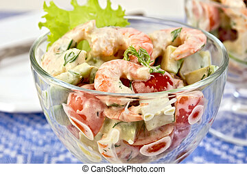 Salad with shrimp and tomatoes in glass