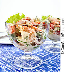 Salad with shrimp and tomatoes in glass on tablecloth