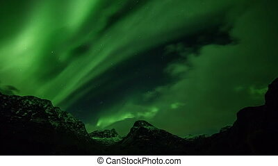 polar lights aurora borealis in the mountains in Norway in a...