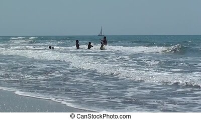 People in the wavy sea