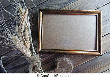 Photo frame and wheat - Old photo frames on wood background...