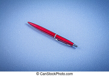 Red biro pen horizontal view office concept