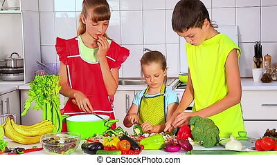 Children cooking at kitchen. - Group of children two girls...