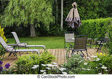 Backyard patio - Wooden patio or deck in backyard of a home...