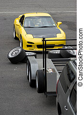 Sports Car Racing - A yellow sports car in the race track...