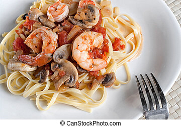 Shrimp Over Linguine - A delicious shrimp scampi dinner with...