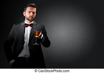 Young man with a cocktail glass