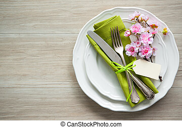 Easter table setting with spring flowers and cutlery....