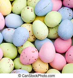 Easter eggs - Blue, pink, yellow and green chocolate easter...