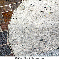busto arsizio abstract pavement of a curch and m - busto...