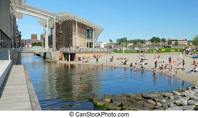 """people swimming at astrup fearnley museum, oslo downtown,..."