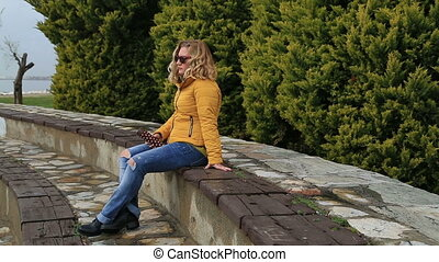 Sad woman alone at the outdoor - Thoughful woman sitting...
