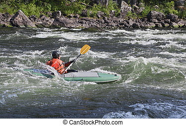 Kayaker in whitewater - Kayaker in the whitewater of a river...