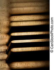 Piano keys and sheet music - Piano keys close up with sheet...
