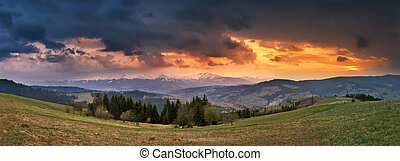 April storm and sunset in mountains. Spring evening