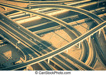 Top view of highway interchange in Dubai, UAE Toned shot