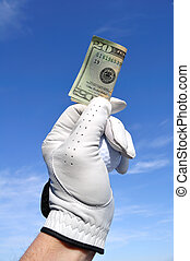 Golfer Holding a Twenty Dollar Bill - Golfer Wearing Golf...