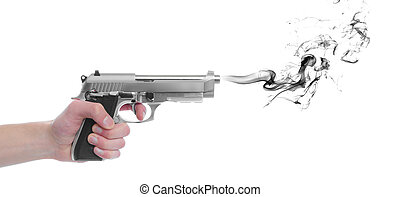 Pistol gun with smoke - A hand gripping a pistol grip hand...