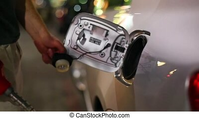 Fuel Station Filling up - Filling fuel into a car