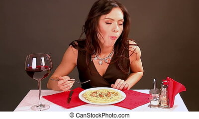 Woman eating spaghetti and meat. - Timelapse of woman eating...