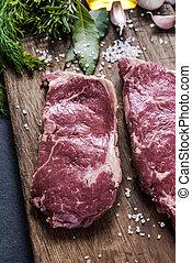 Beef stirloin raw steaks with herbs