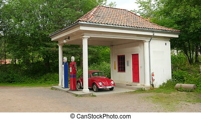 """historical street with gas station, industrial age view, oslo, norway"""