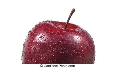 Close-up of a red apple rotating