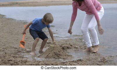 Grandmother and Grandchild at the beach - A grandmother and...