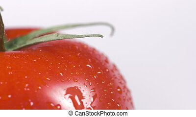 Close-up of a tomato rotating - Close-up of a delicious red...
