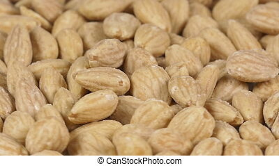 Close-up of almonds rotating - Close-up of almonds on a...