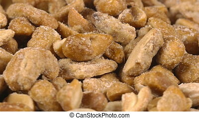 Close-up of nuts rotating - Close-up of mixed nuts on a...