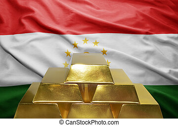 tajikistan gold reserves - shining golden bullions on the...