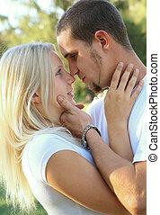 Romantic Caucasian Couple Embracing In Park - passionate...