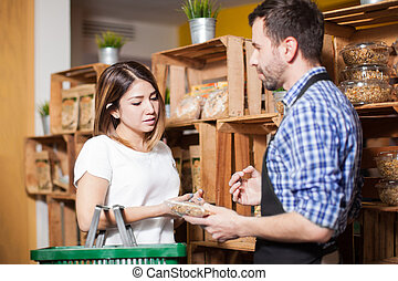 Getting some help from a store clerk - Cute brunette getting...