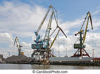 Port. Portal cranes - Bridge cranes at the sea port. Coal...