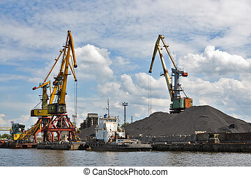Port. Portal cranes - Bridge cranes at the sea port. Coal...