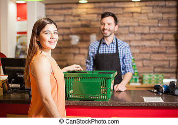 Gorgeous Latin girl buying groceries - Portrait of a...