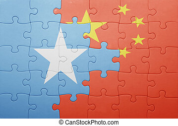 puzzle with the national flag of china and somalia . concept