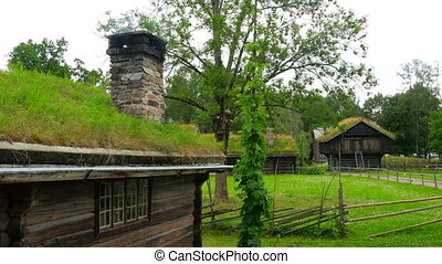 """""""chimney of house with green grass rooftop smoking, norway, 4k"""""""