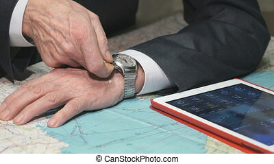 Business man starts up his mechanical watch Closeup