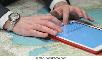 Businessman writes  report using a tablet. Closeup