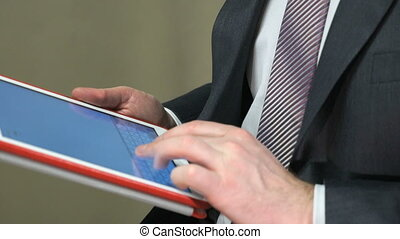 Businessman looks for texts using a computer