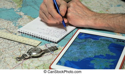 Pilot records the weather forecast in a notebook - Pilot is...