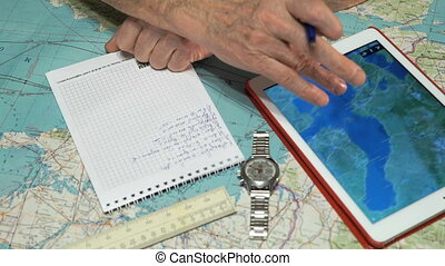 Pilot is watching the weather on digital tablet - Pilot is...