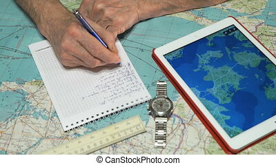 Pilot records the weather forecast in a notebook - Pilot...