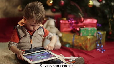 boy got the gift- tablet PC - Child playing on digital...
