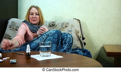 The girl is sick and taking medication.