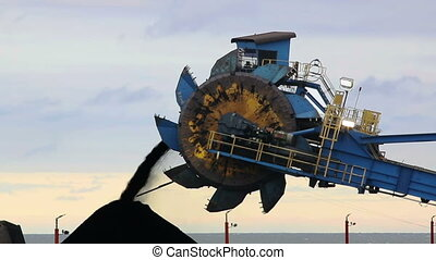 Piling Coal with Heavy Machinery - Coal is piled with heavy...